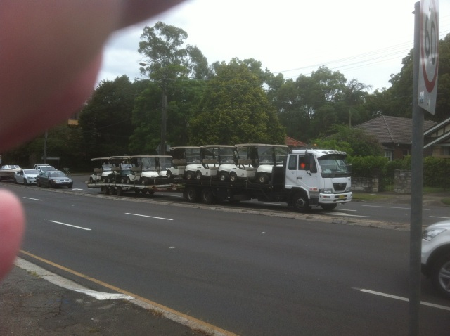 Golf-cart transporter, halfway between Roseville and Chatswood, 25 January 2014 (Black and Blue Man)
